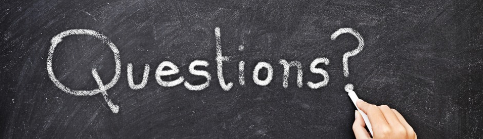 "Word ""question"" in chalk on blackboard - hand holding chalk putting dot under question mark"