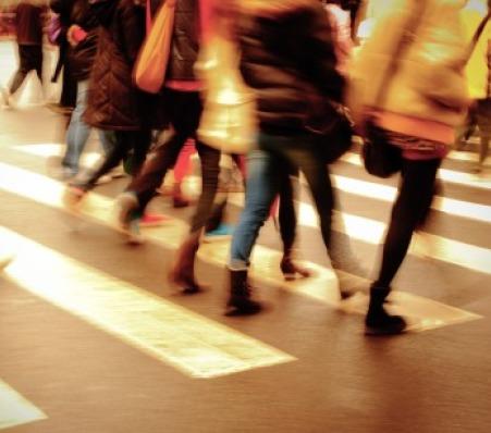 Crowd walking on zebra crossing